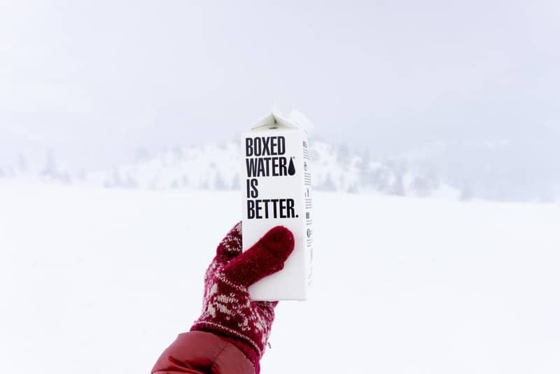 Ghostwriter image - box of water with & boxed water is better & written on the side